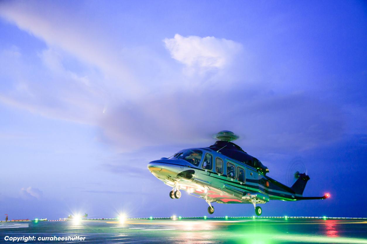 helicopter parking landing on offshore platform. Helicopter transfer crews